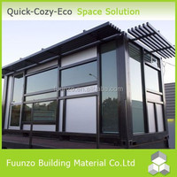Daylighting Strong Plastic Timber Cladding House with Glass Walls