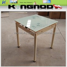glass top cream colored dining room table and chairs