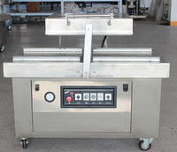 Double chamber vacuum sealing machine for frozen chicken wings
