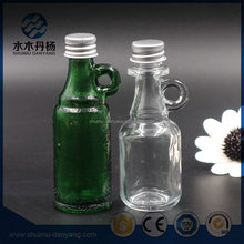 Wholesale mini drinking/beer/juice/wine/vodka/beverage glass bottle with handle and screw aluminum cap
