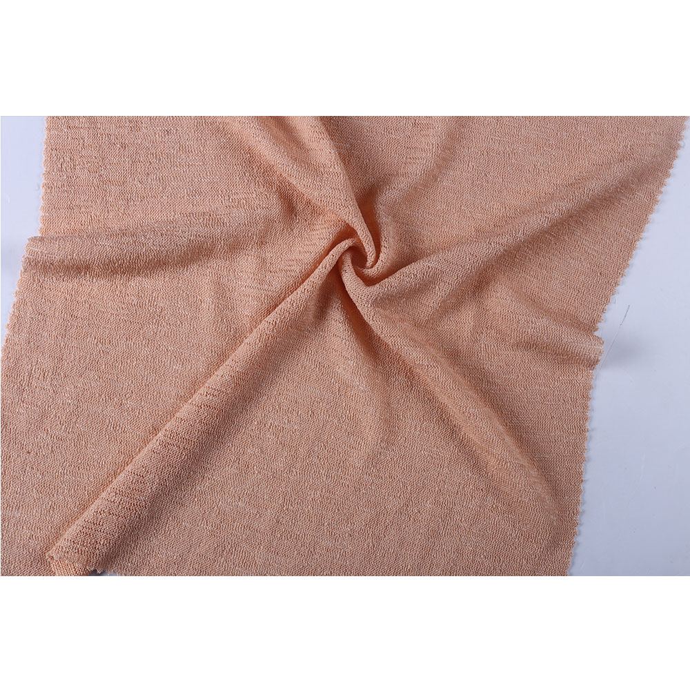 Light dyed single plain jersey knit dress fabric