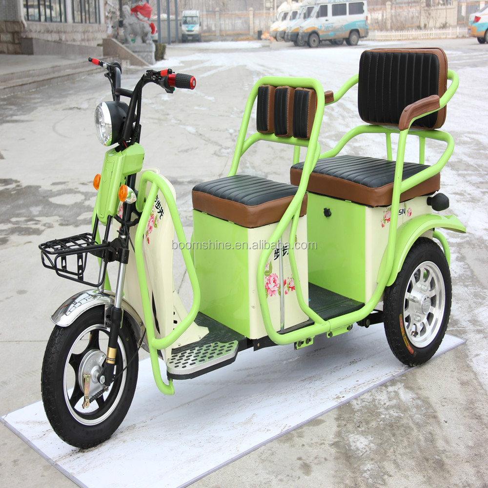 battery operated electric three wheeler with passenger seat