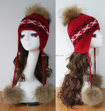 Red winter warm ski hats/ knitting hat cover the ear with long lie fur pompons