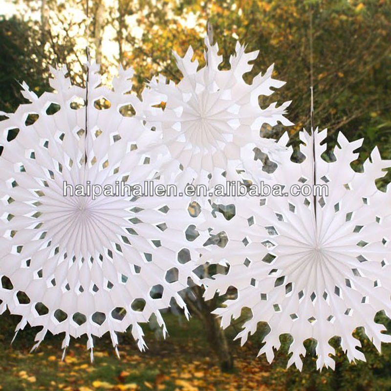 White snowflake shape tissue paper fans for party decoration