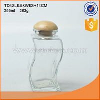 Machine made high quality curve shaped airtight glass storage jars glass bottle with wooden lid.