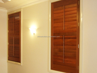 Wooden plantation red shutters