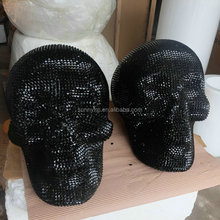 Large fiberglass skull sculpture with fake diamond