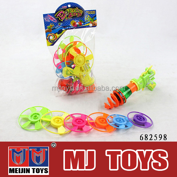 custom wind up toys rocket spinning top wholesale
