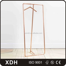Metallic champagne gold clothes display stand for store use