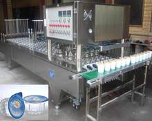 Automatic liquid filling sealing machine for mineral water cup