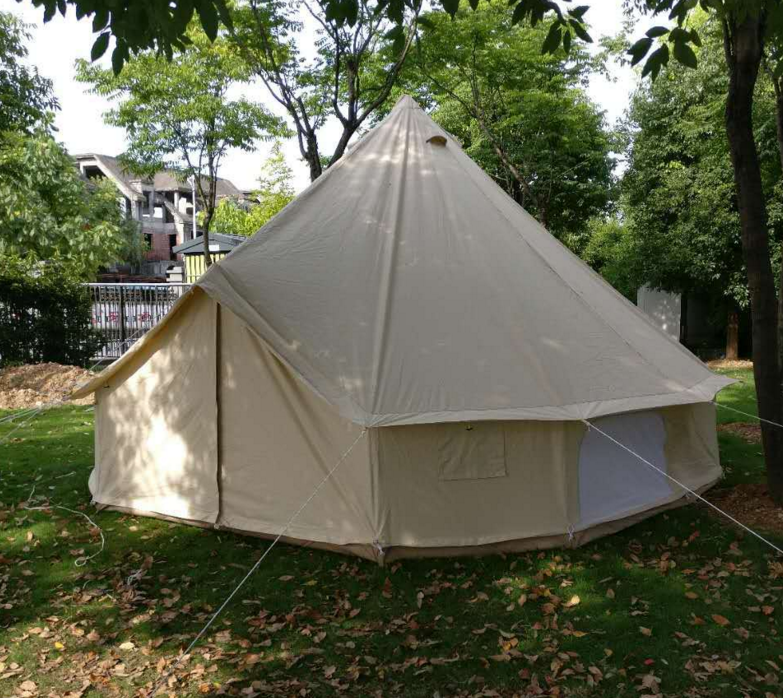 Glamping bell tent for hunting use with smoke stack