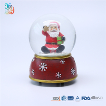 Wholesale custom red resin base christmas musical crystal snowball for sale