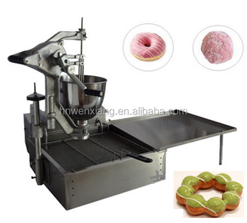 man operated donuts making machine