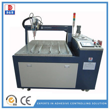 Automatic glue dispensing machine for a b epoxy resin
