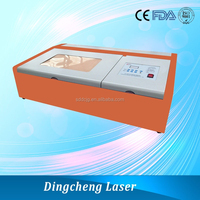 China shandong dingcheng mini 2D laser engraving machine price DC320 for making leather gift