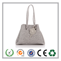 Fashion Triangular Felt shoulder Bag With Exquisite Flower Hanging Ornament