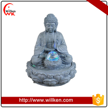 Thai buddha statue rolling ball water fountain