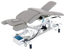 Multi-postural electric treatment and physiotherapy couch