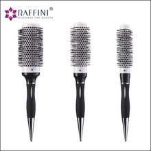 Manufacturing salon market professional grade hard plastic bristle radial barrel hair brush with aluminium tube