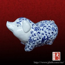 Lovely decorative blue and white ceramic pig figurines