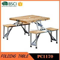 Outdoor wooden picnic table and bench