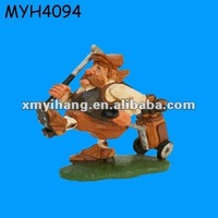 old golfer resin figurine with the golf trolleys