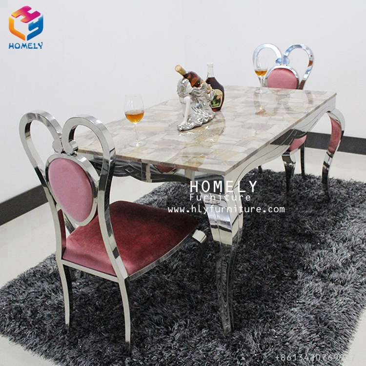Luxury gold stainless steel dining table with leather chairs