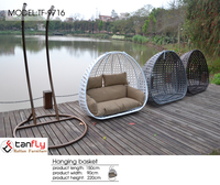 Outdoor & indoor rattan hanging chair with stand.