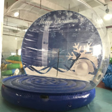 PVC 0.9mm material high quality cheap snow globe for people jumping/ inflatable snow globe with blowing snow