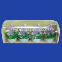 opening flower tealight candles in wooden base