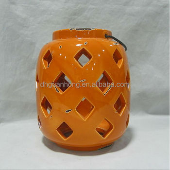 Hot sale handmade craft orange hollow hanging ceramic lantern