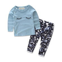 New Autumn baby girl outfit suits Printed sleeping eyes eyes lovely fashion cotton baby girl sets 2pcs T-shirt + pants
