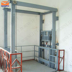 Vertical wall mounted warehouse elevator lift goods freight hydraulic lift platform