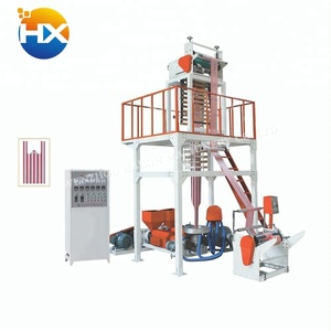 Roll-changing easy double color film blowing machine with a plug-in plate mechanism