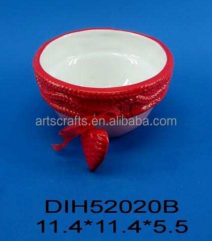 Small ceramic bowl with red ribbon tie