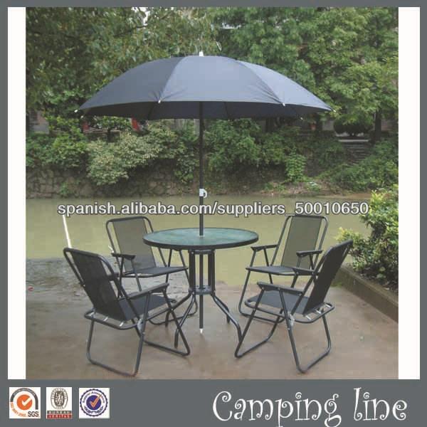 juego mesa de comedor con sillones y sombrilla de exterior