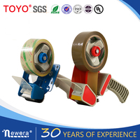Hand held metal packing tape dispenser