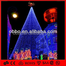 Outside Building decorative lighted Christmas tree with top angel