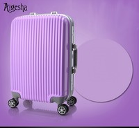Purple travel suitcase with big silent wheels
