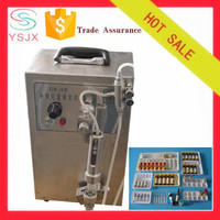 Portable manual glass bottle pharmacy liquid filling machine