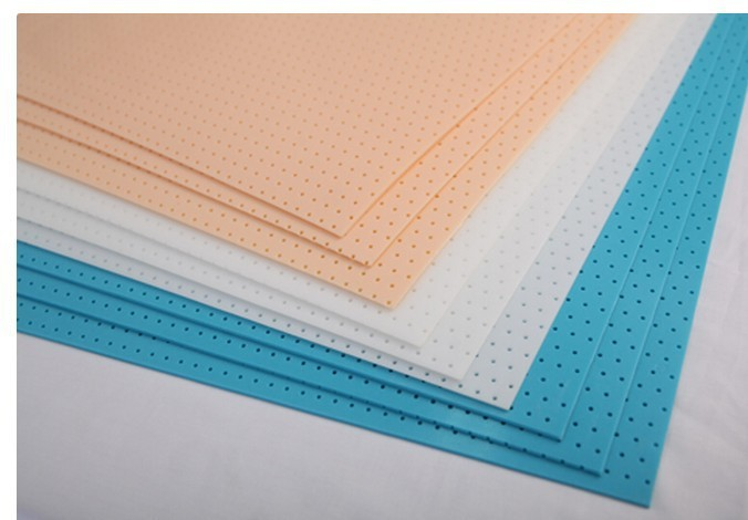 Reusable low temperature thermoplastic sheet, orthopedic splint