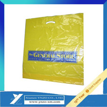 Plastic die cut handle bag with patch handle reinforce