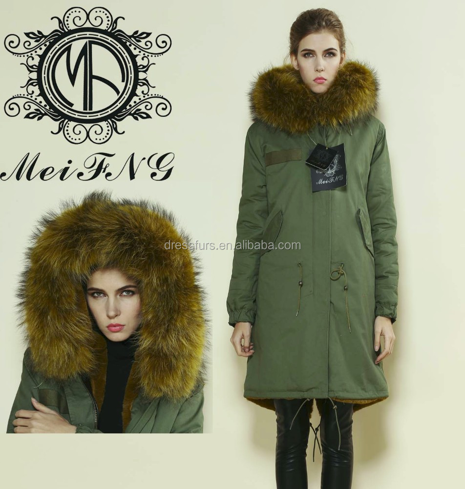 Woman charming long version green parka fur trimming coat