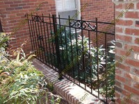 Wall mounted artistic wrought iron fence