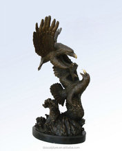 two large bronze eagle sculptures