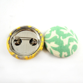 Metal back with tin fabric covered badge button/safety pin