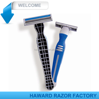 twin blade shaver with lubricant strip , rubber handle