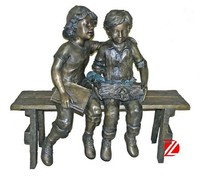Bronze garden statues children sitting on bench playing for sale