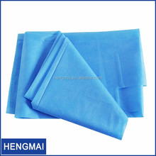 Non woven Perforated Roll Bed Sheet Plastic Bed Cover Sheets Disposable Surgical Draw Sheet Medical Table Paper Roll