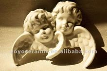 white porcelain angel head with wing ornament